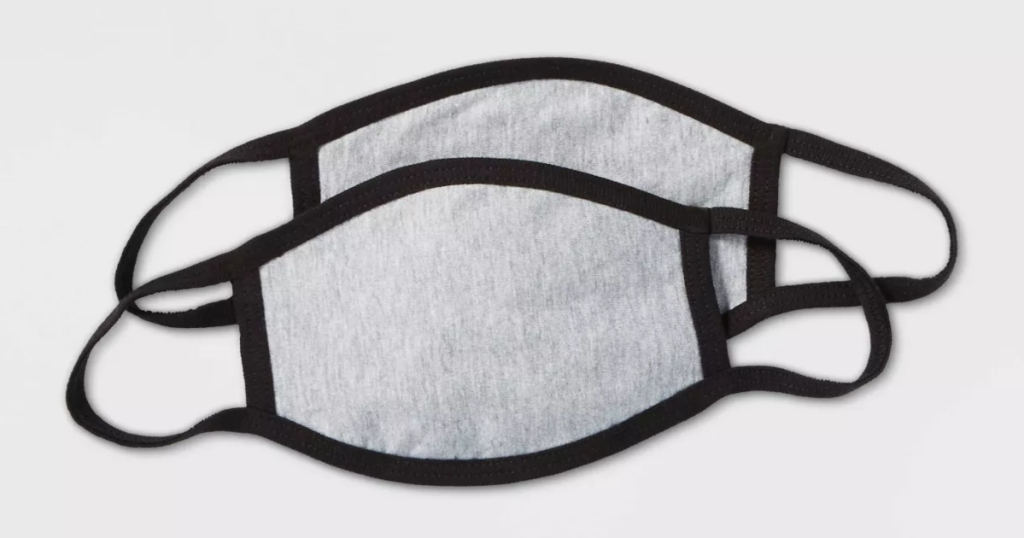 two kids sized fabric masks in grey and black