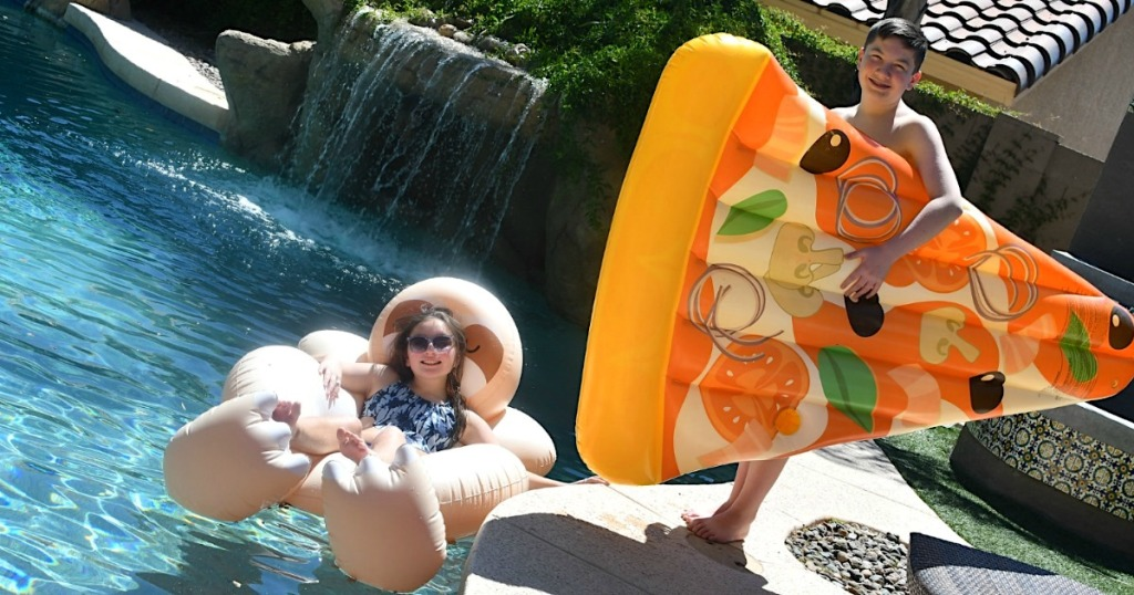 girl in pool on float, boy holding pizza float