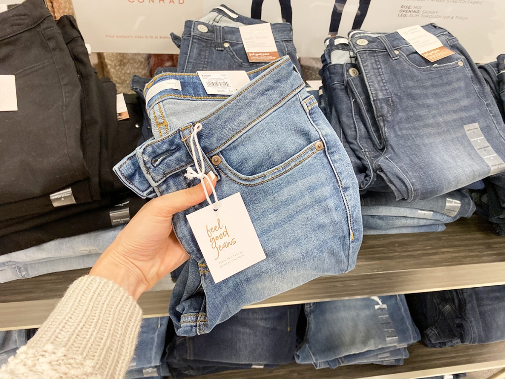 holding up a pair of lauren conrad jeans at kohls
