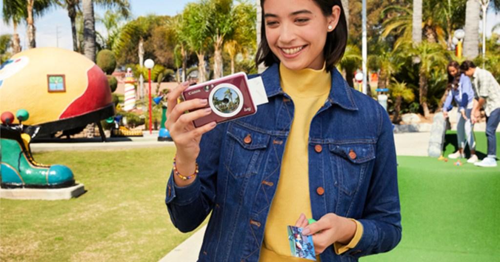lady holding Cliq camera