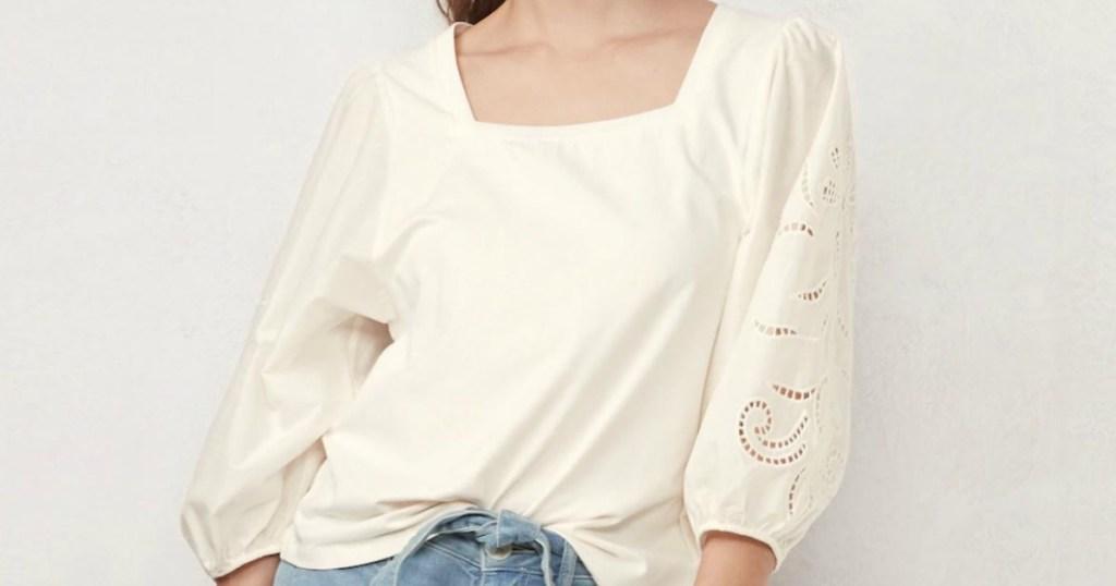 woman wearing cream colored shirt