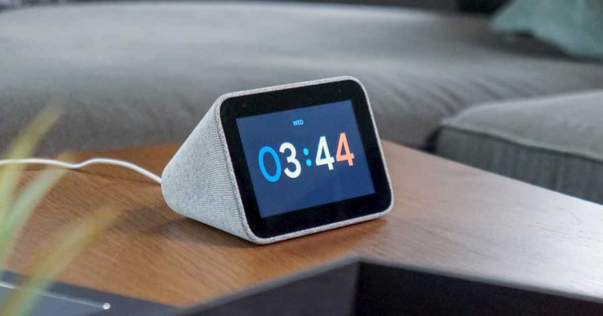 smart clock with google assist on table