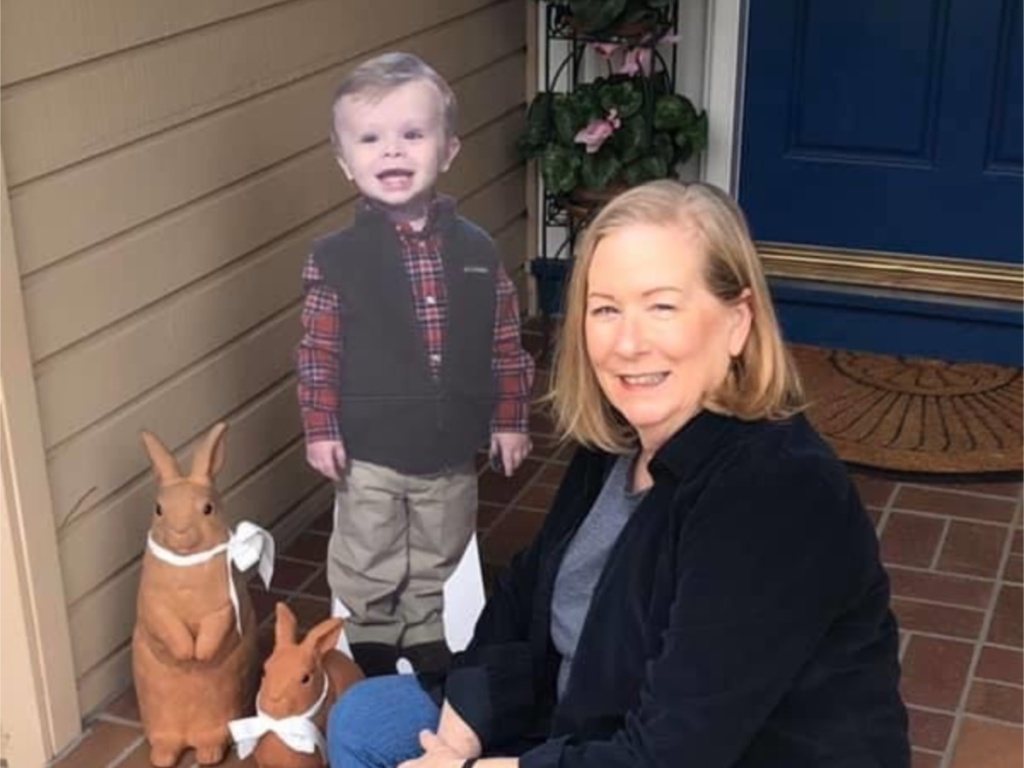 life size cutout of toddler next to woman