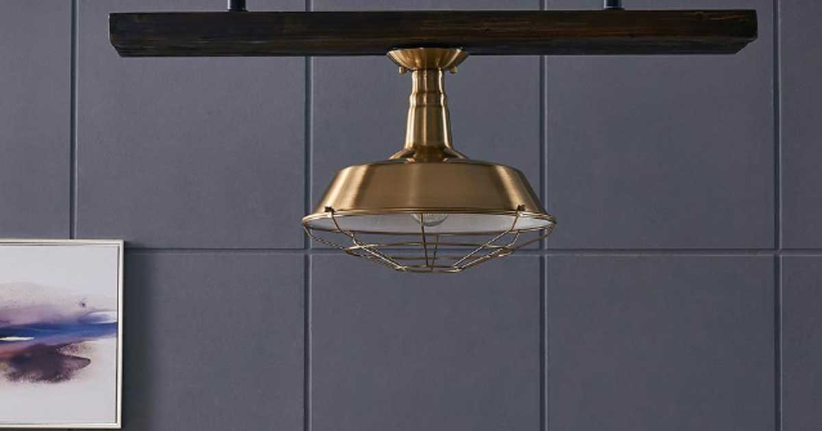 brass wire light hanging from ceiling