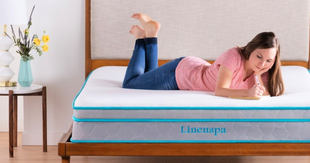 linenspa mattress with woman laying on top