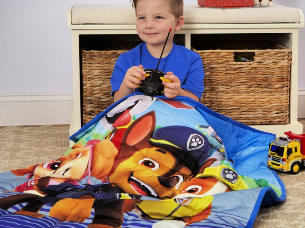 little boy sitting on floor with PAW Patrol Kids 4.5lb Weighted Blanket