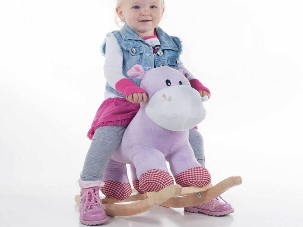 hippo riding rocker toy with little girl sitting on it