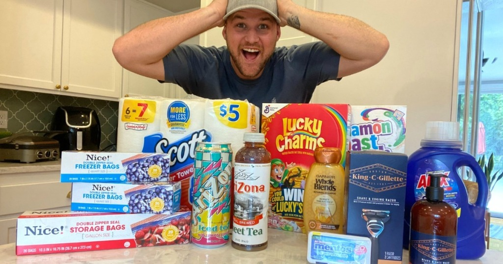 man mind blown about all the walgreens deals he scored sitting on counter in front of him