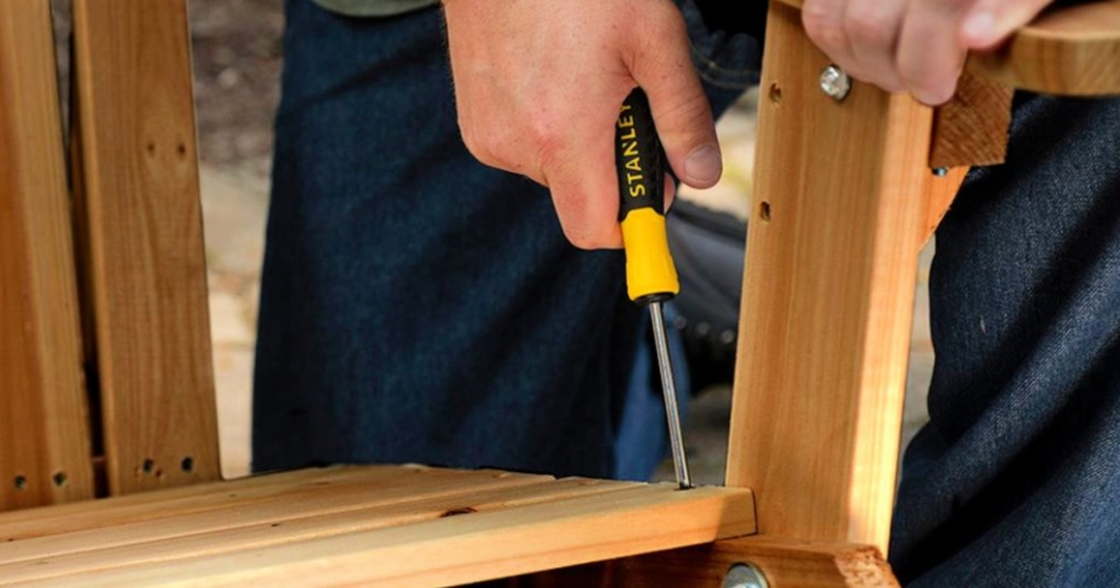 man using stanley screwdriver