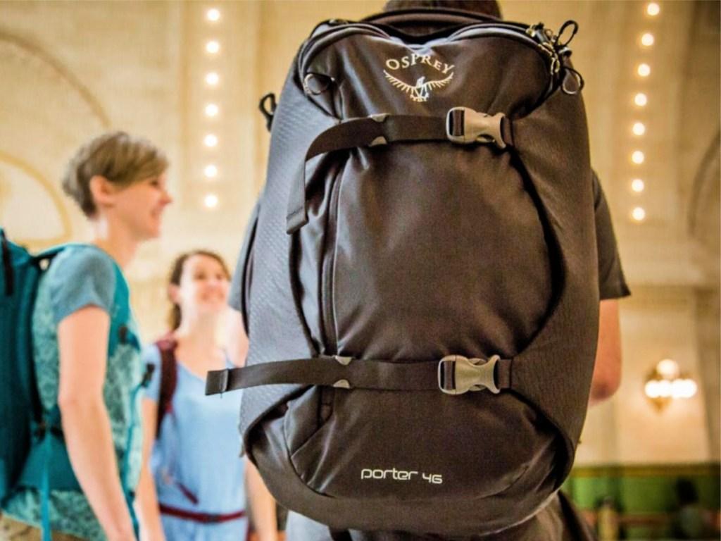 man with Osprey porter 46 bag on back