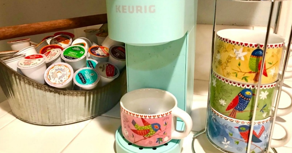mini Keurig coffee maker on counter with k-cups