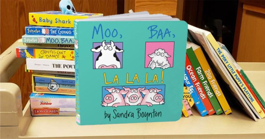 moo baa la la la book in front of books