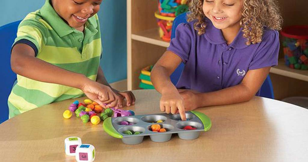 boy and girl playing with muffin learning game