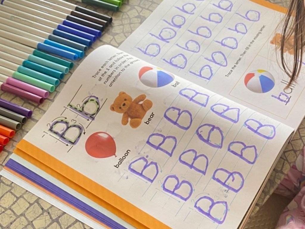 handwriting workbook open to B page