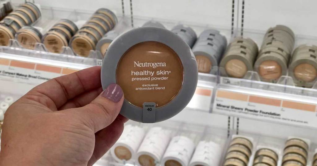 hand holding pressed powder item in store