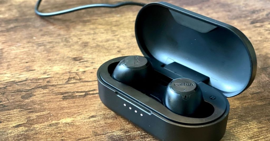 Earbuds in a case charging