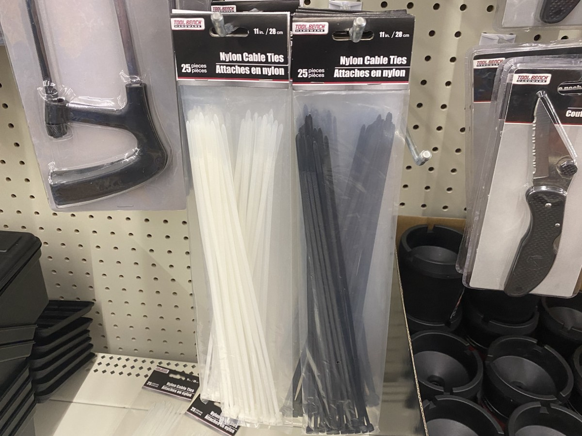 nylon cable ties hanging on pegs at Dollar Tree