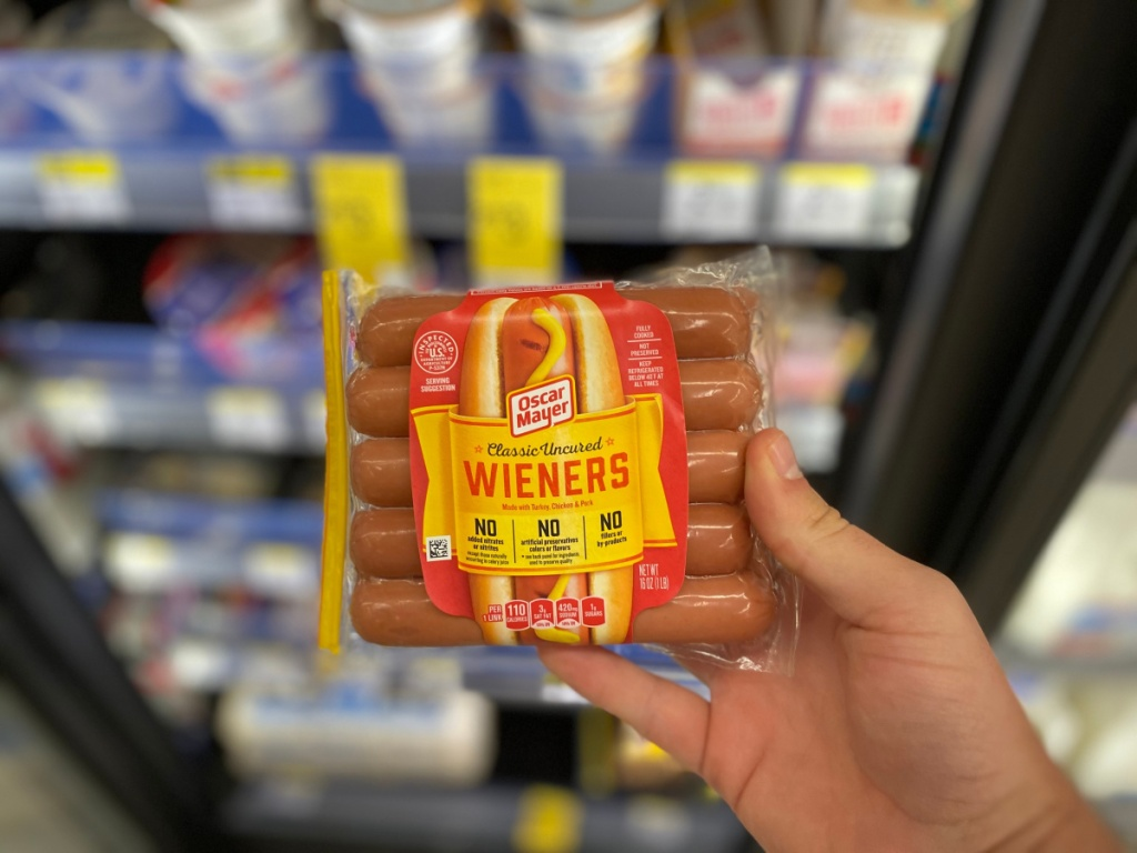 hand holding package of Oscar Mayer weiners