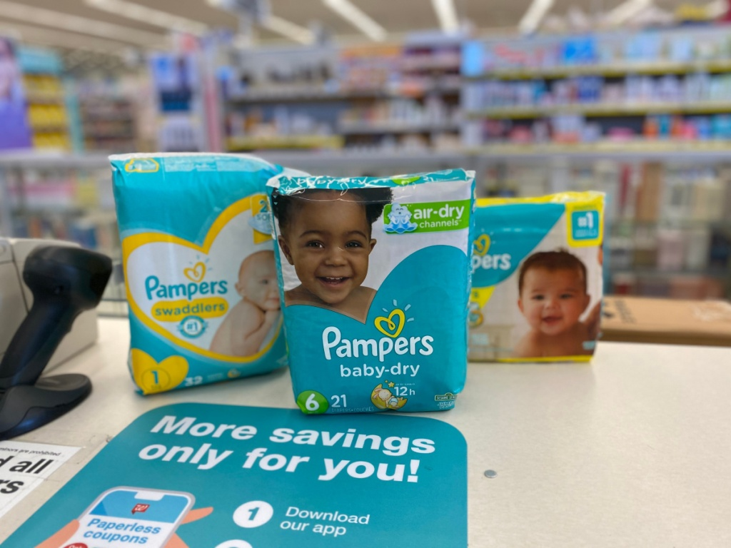 3 packs of pampers diapers on store counter