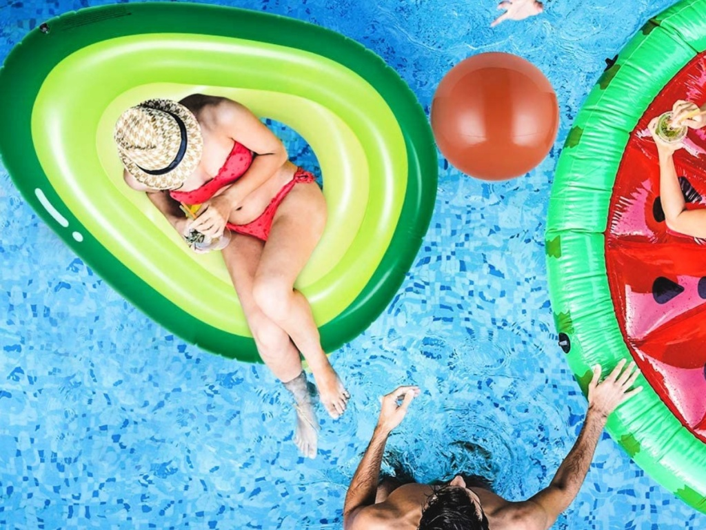 people playing pool with an Obuby Inflatable Avocado Pool Float