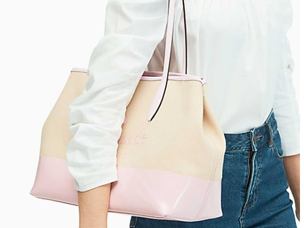 pink and beige purse on side of lady