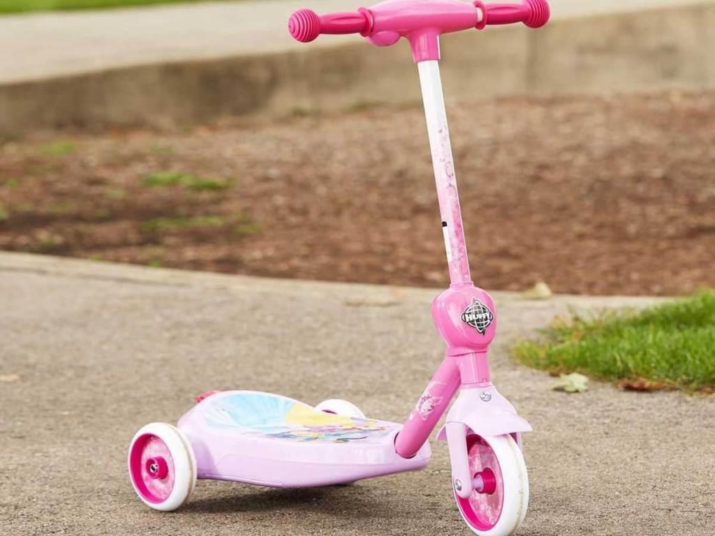 disney 3 wheel scooter on a sidewalk