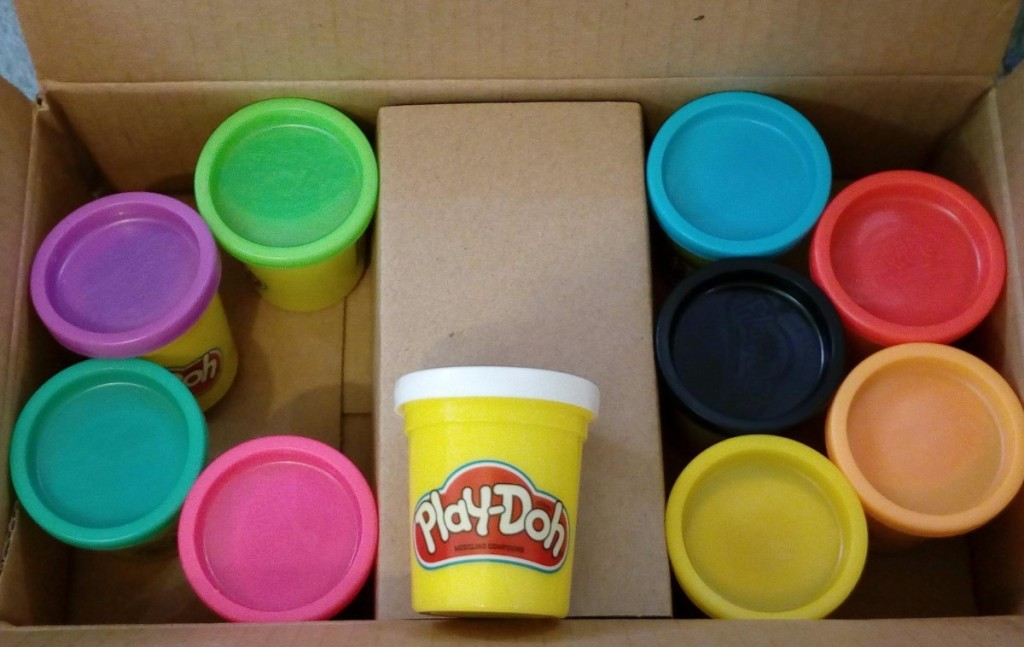 10 canisters of Play-Doh in cardboard box
