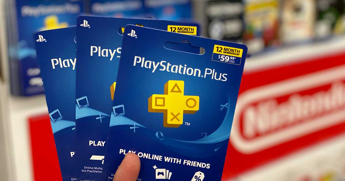 hand holding three playstation plus cards