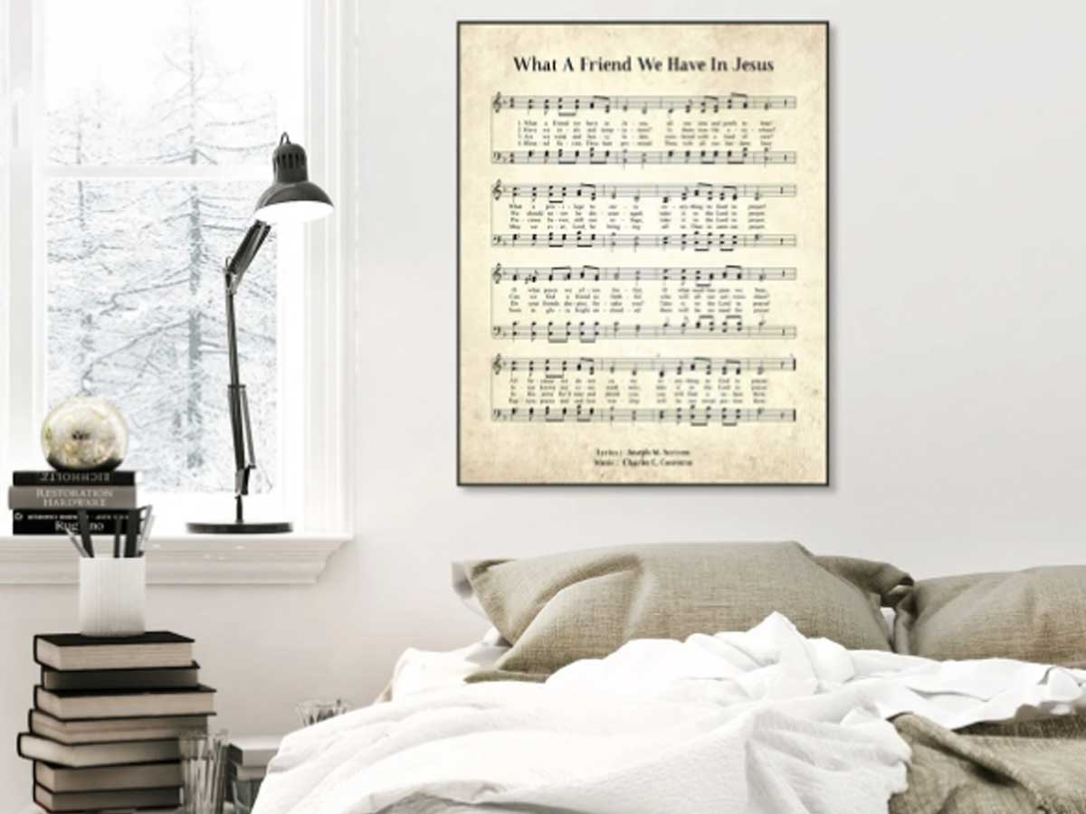 framed hymn print on a wall in a bedroom