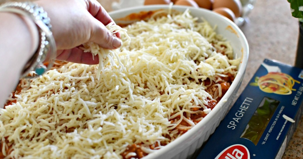putting cheese on top of million dollar casserole