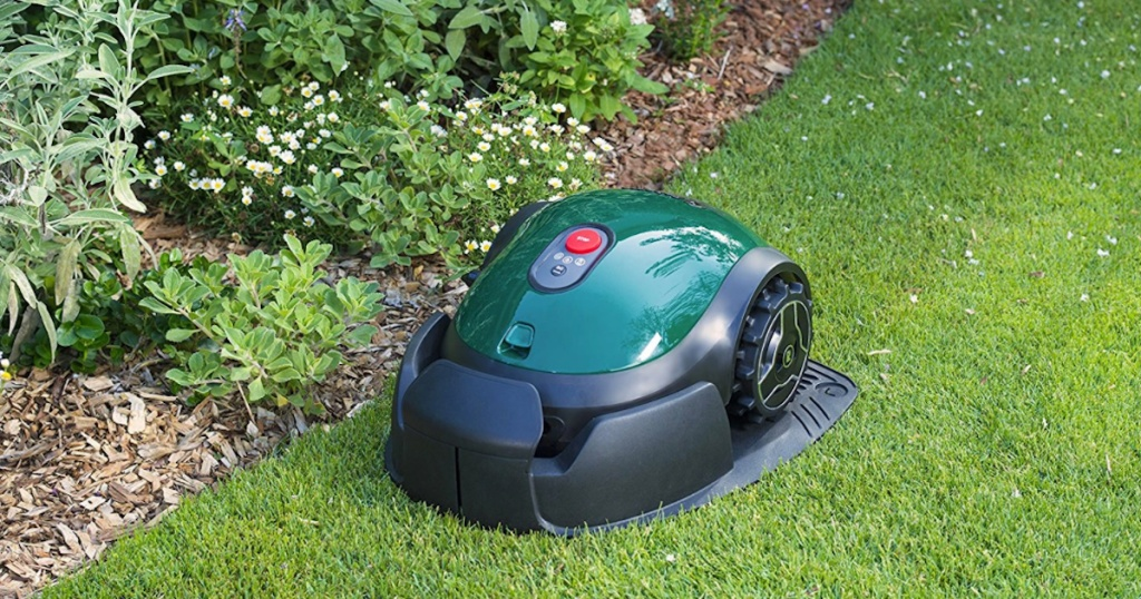 mowing device on green grass