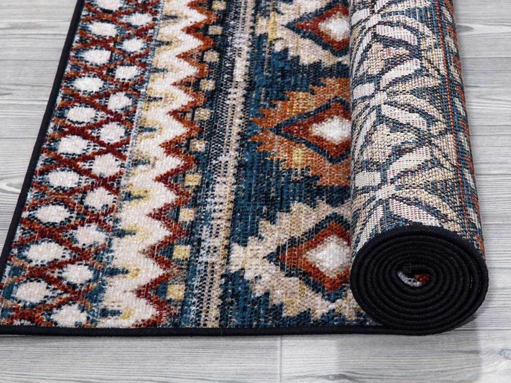 rolled up multi colored rug
