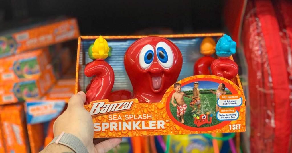 hand holding an octopus sprinkler