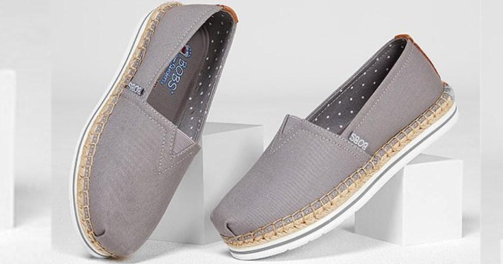 gray slip on skechers bobs shoes on white blocks