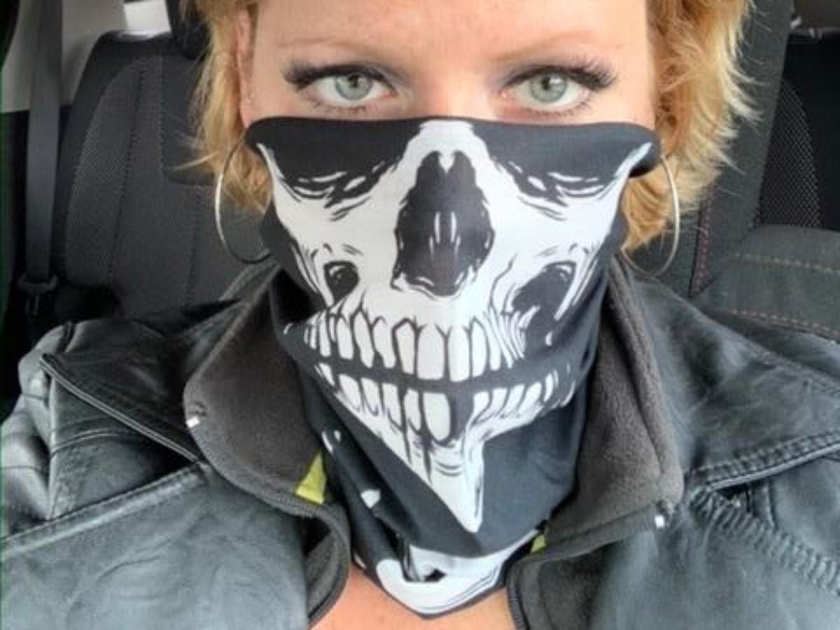 woman wearing skeleton neck gaiter
