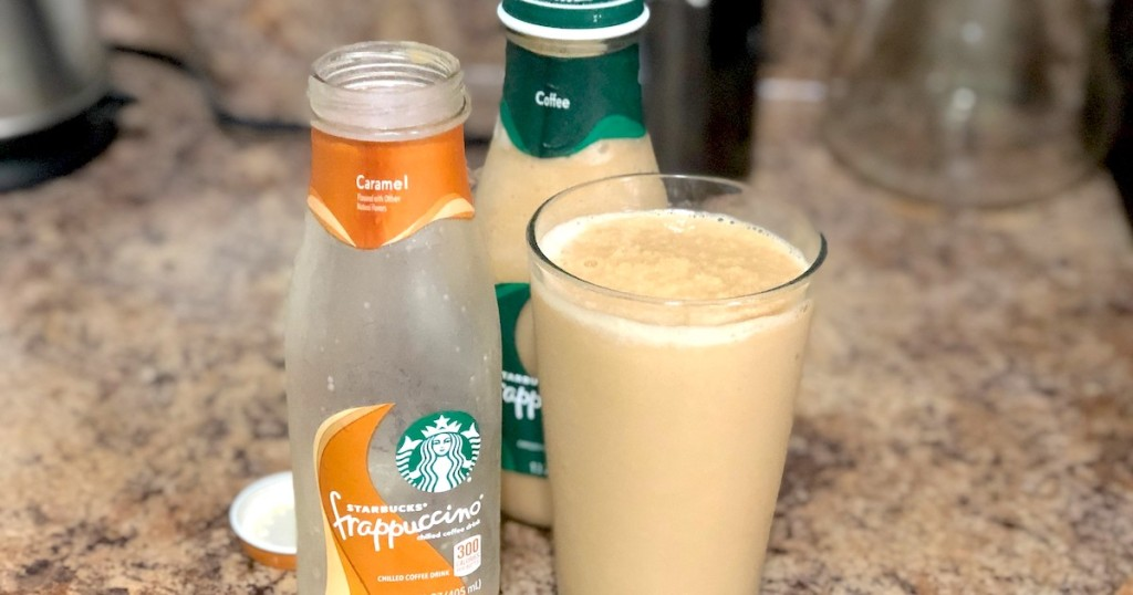 empty starbucks bottle with glass full of frappuccino