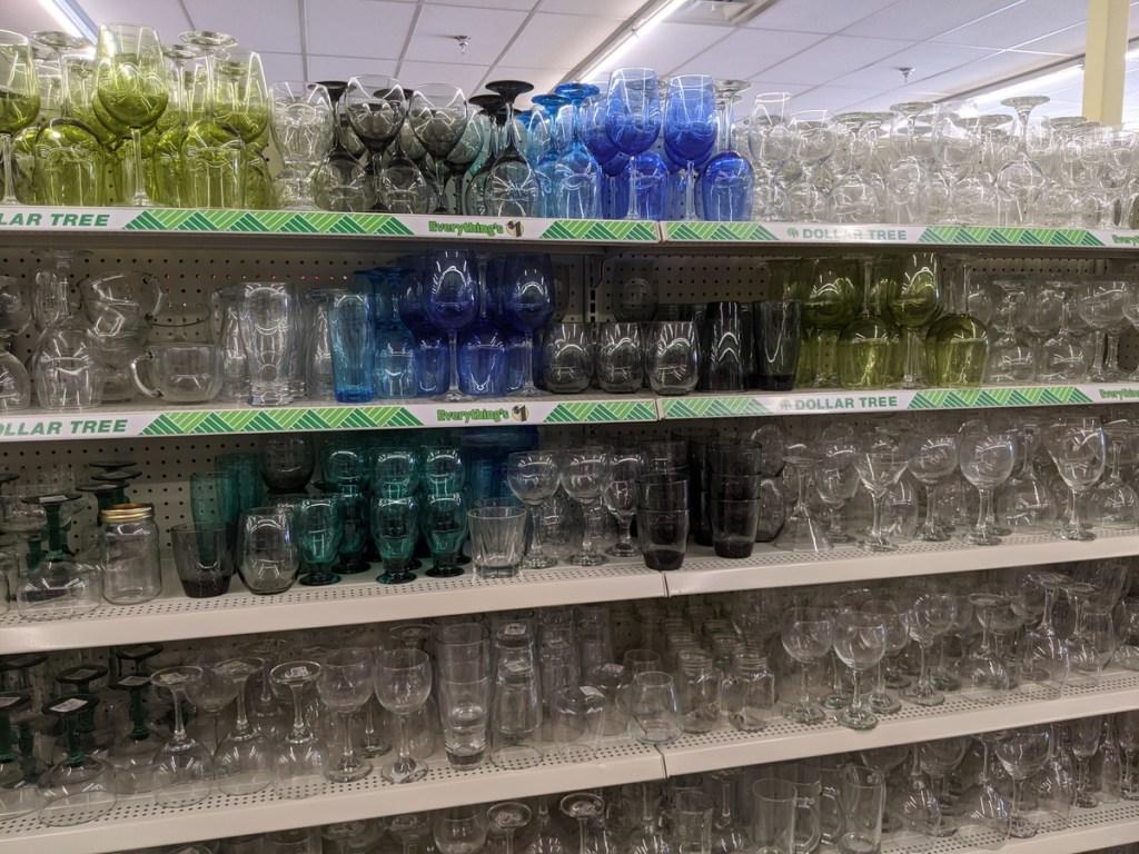 5 shelves full of drinking glasses in dollar store