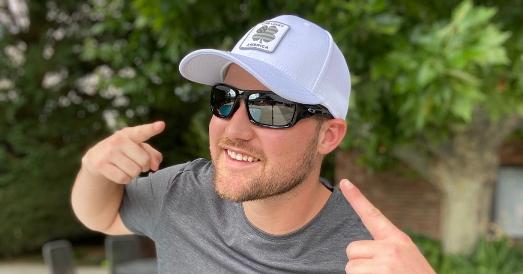 man wearing Oakley Men's Valve Sunglasses with white hat on outside