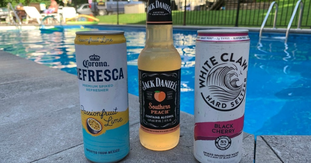 adult summer cocktails sitting by pool