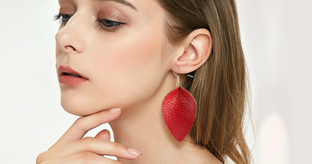 woman wearing red leather teardrop earring