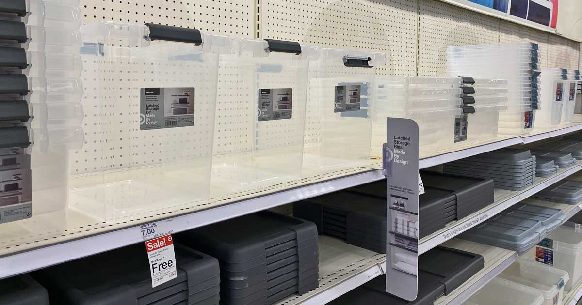 storage bins with latching lids on shelf in store