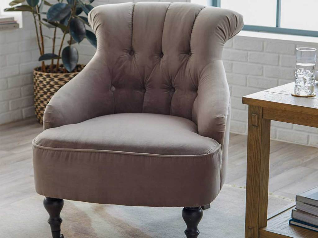 tufted accent chair in living room