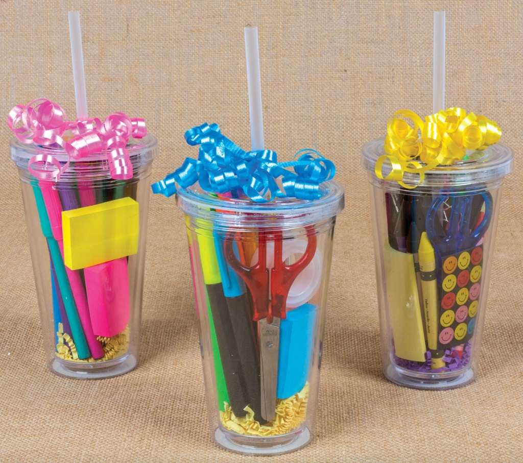 clear tumblers with straws and school supplies inside topped with colorful ribbon purchased at dollar tree online