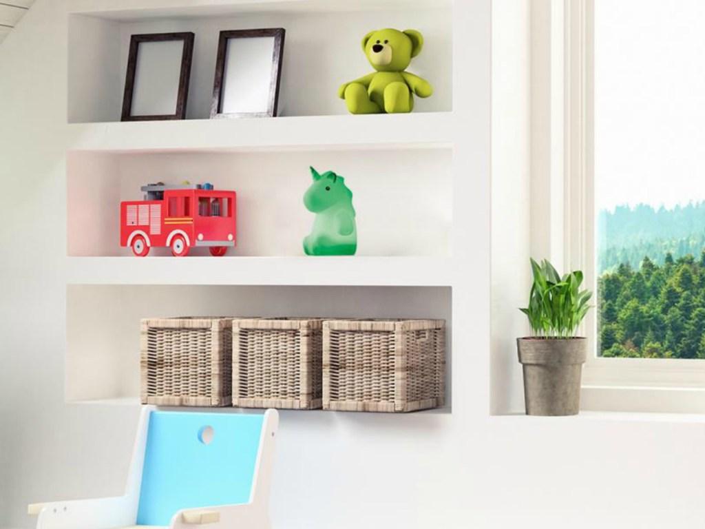 kids shelves in bedroom with knick knacks on it