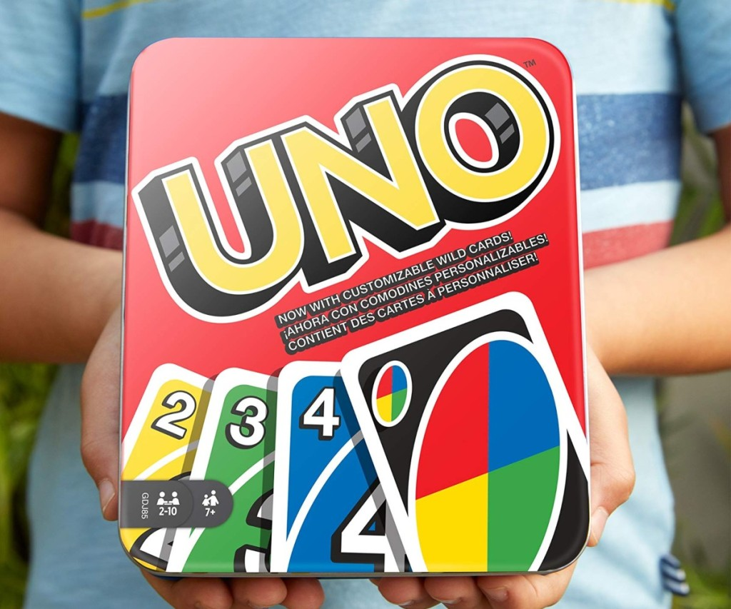 boy holding uno game in metal tin
