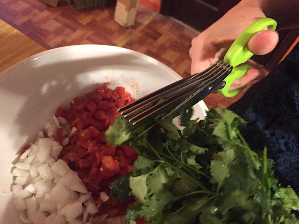 using Herb Scissors with cilantro in bowl