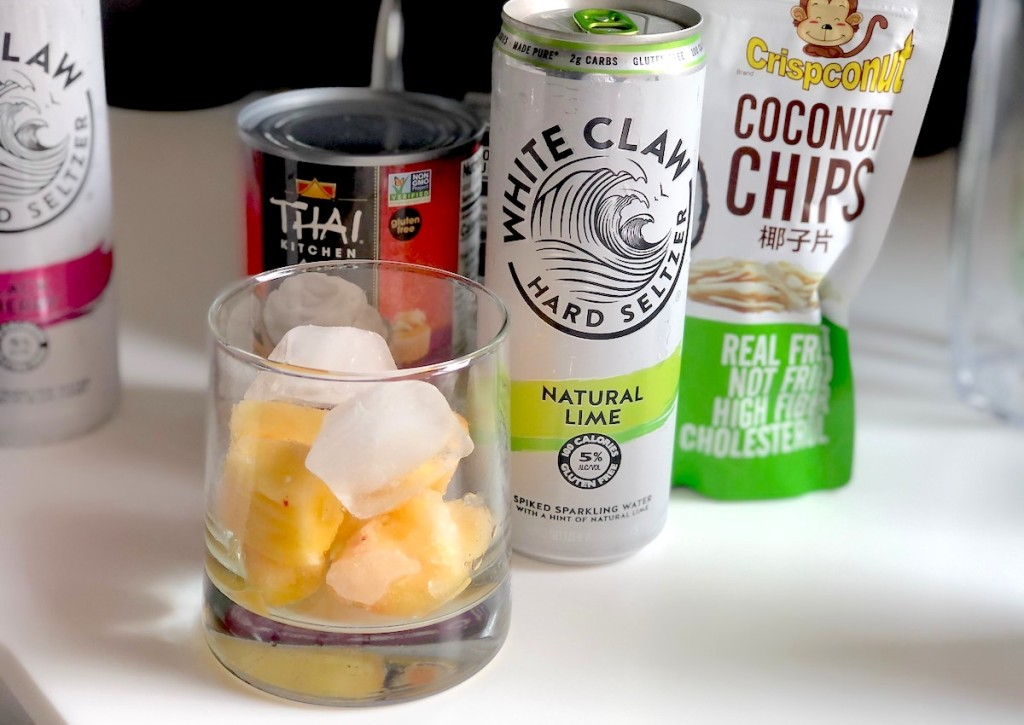 white claw can with cup full of frozen fruit