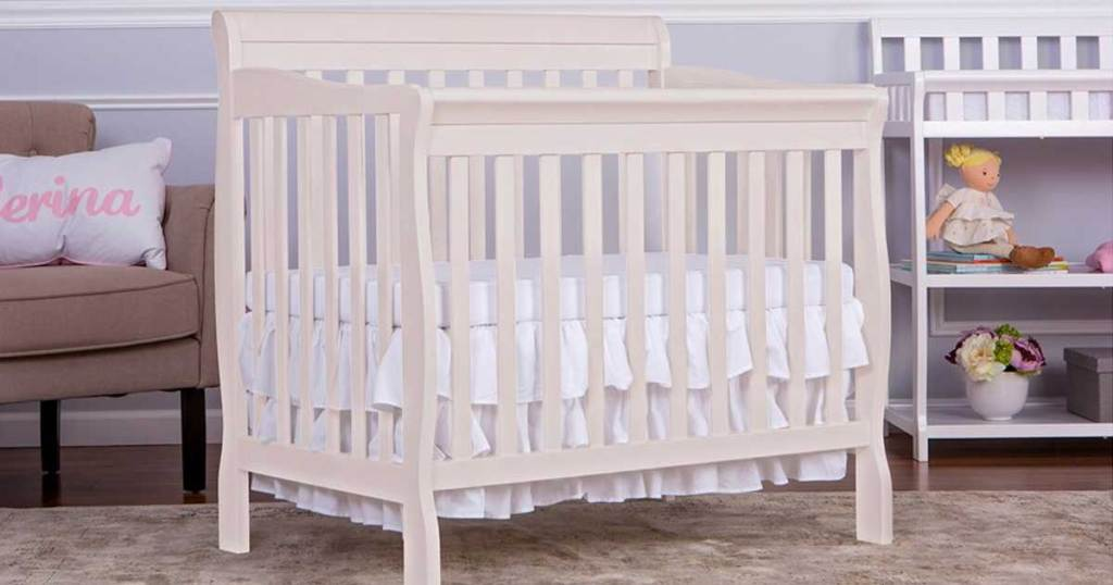 white baby crib in baby room