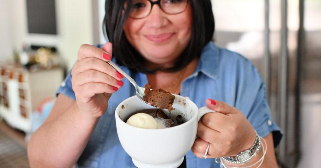 woman holding a nutella mug cake