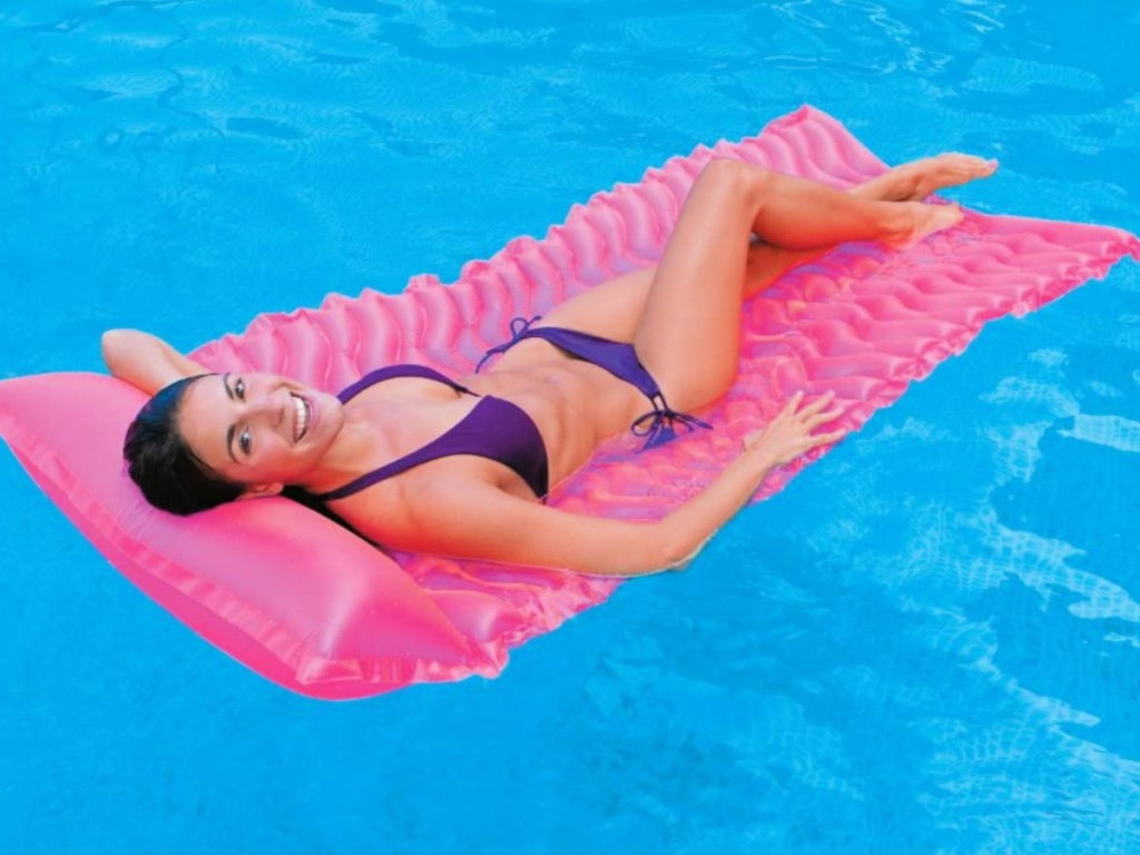woman laying on a pink Intex Tote-N-Float Wave Inflatable Air Mat